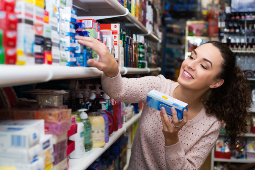 woman shopping for toothpaste