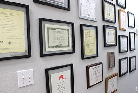 dental diplomas and accolades on a wall