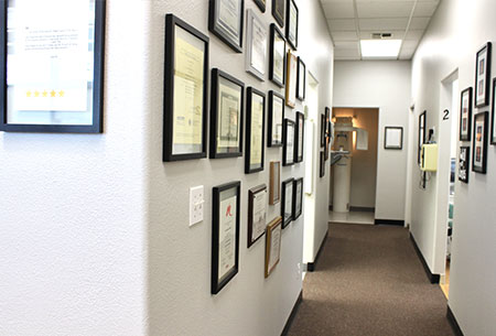 hallway of exceptional dentistry, with diplomas and accolades on the wall