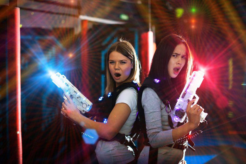 young women playing laser tag